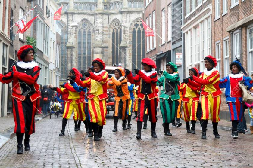 Dancers dressed as Zwarte Piet
